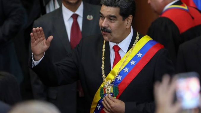 epa07316641 Venezuelan President Nicolas Maduro (C) arrives at the opening ceremony of the judicial year, in Caracas, Venezuela, 24 January 2019. Maduro received the endorsement of Supreme Court magistrates, amidst his legitimacy crisis and the self-proclamation of deputy Juan Guaido as interim president. EPA-EFE/CRISTIAN HERNANDEZ